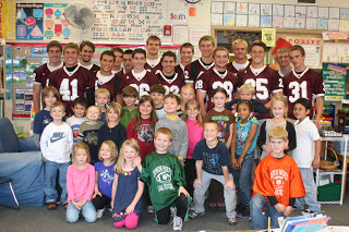 Varsity Football Players Read to North Elementary Students