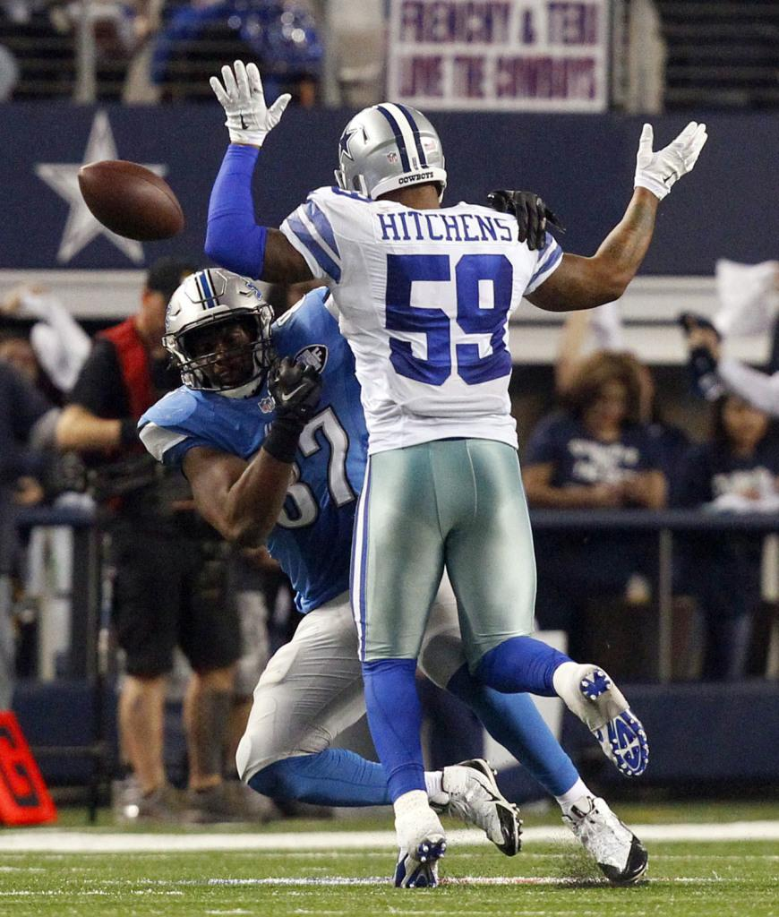 Dallas Cowboys outside linebacker Anthony Hitchens (59) gets hit in the back by a pass to Detroit Lions tight end Brandon Pettigrew (87) in the fourth quarter at AT&T Stadium Sunday, Jan.  4, 2015 in Arlington, Texas. The Cowboys beat the Lions 24-20.
