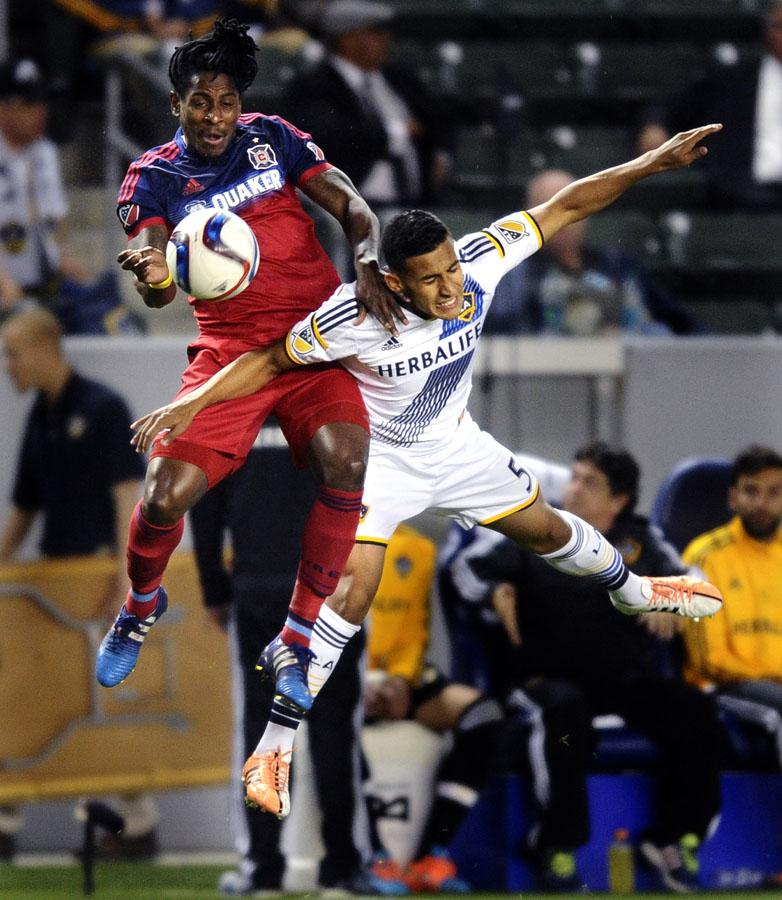 The Chicago Fire's Lovel Palmer, left, and the Los Angeles Galaxy's Jose Villarreal collide while battling for a ball in the first half at the StubHub Center in Carson, Calif., on Friday, March 6, 2015.