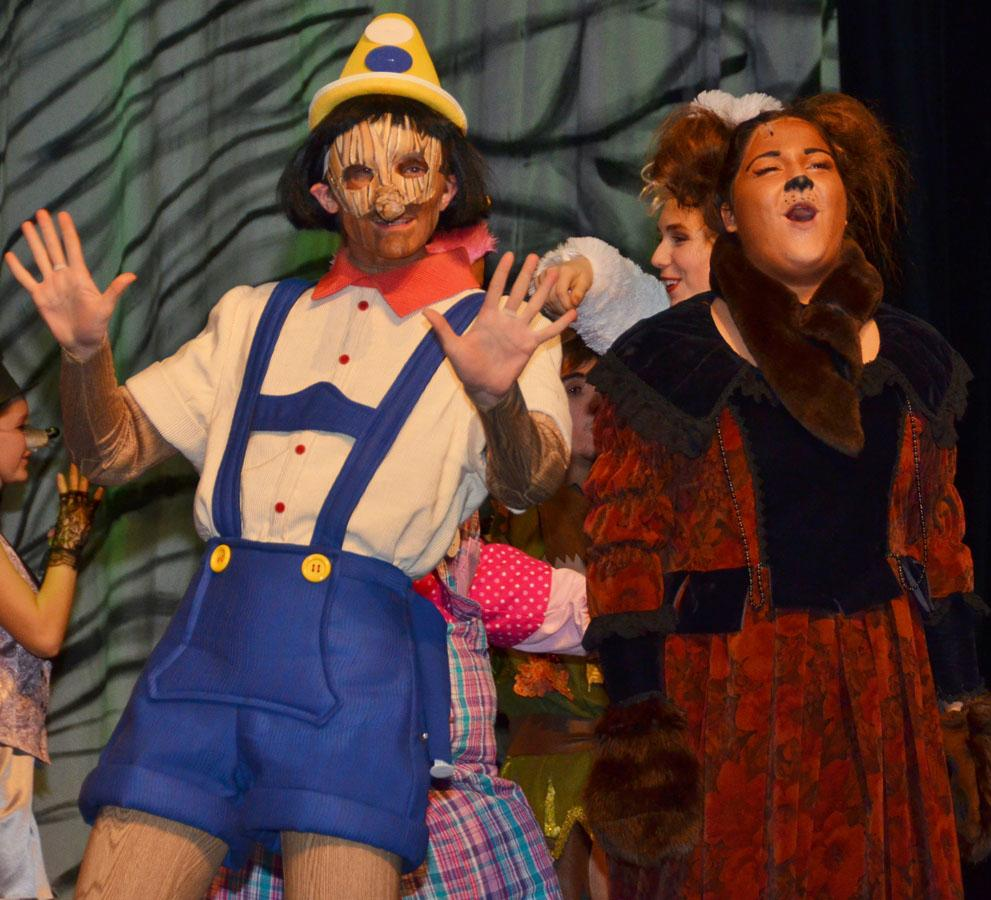 Senior Jimmy Bossemeyer and junior Lexi Viegas perform as Pinocchio and Mama Bear in Prairie Ridge's production of Shrek the Musical.