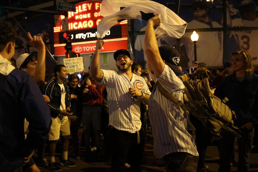 Fans celebrate in Wrigleyville as the Chicago Cubs beat the Pittsburgh Pirates, 4-0, in the National League Wild Card Game on Wednesday, Oct. 7, 2015, at the Cubby Bear in Chicago.