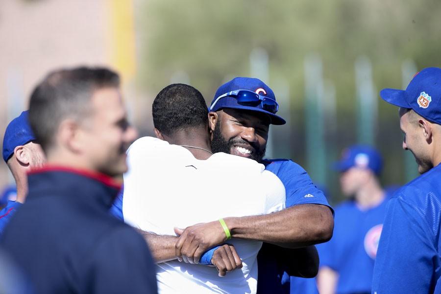 Chicago Cubs outfielder Jason Heyward hugs Dexter Fowler during Cubs spring training at Sloan Park in Mesa, Ariz., on Thursday, Feb. 25, 2016.