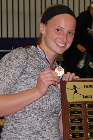 Annie Timm poses with the FVC Conference plaque after taking first place in No. 1 Singles.