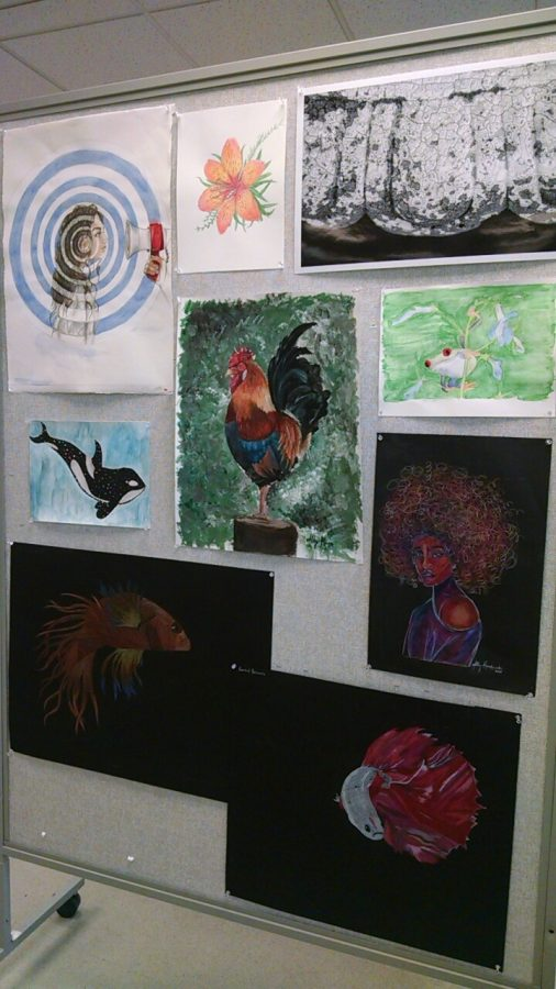 Original+artwork+by+PRHS+students+has+been+on+display+in+the+library+in+recent+weeks.