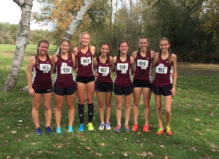 Chelsea (third from the right) and the rest of the girls XC team pose after their regional race on Saturday, October 21st in Wilmot Wisconsin.