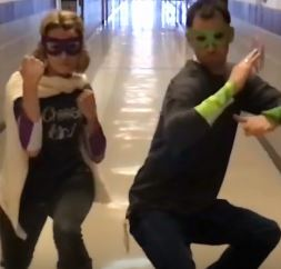 Mrs. Berg and Mr. Powell strike a superhero pose as the new Digital Citizen Defenders.