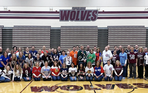 Prairie Ridge faculty and staff gathered before school for a picture on Friday, April 12, 2019, wearing jerseys in honor of Mr. Mason who loved to wear jerseys and have fun.