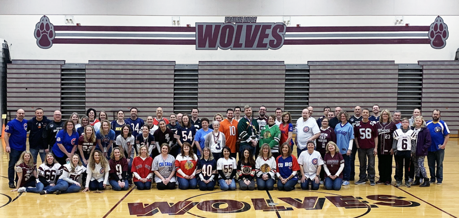Prairie+Ridge+faculty+and+staff+gathered+before+school+for+a+picture+on+Friday%2C+April+12%2C+2019%2C+wearing+jerseys+in+honor+of+Mr.+Mason+who+loved+to+wear+jerseys+and+have+fun.
