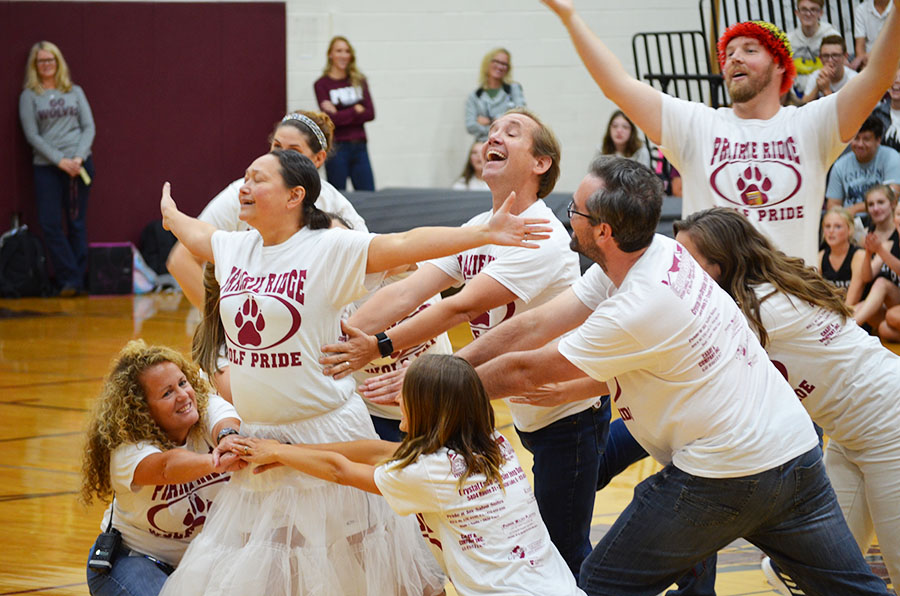 Prairie Ridge High School Teachers pose at the end of their dance feature during the fall 2018 Homecoming Assembly. The teacher dance is always a crowd favorite.