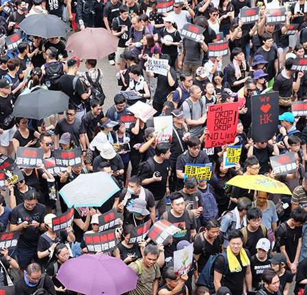 Protestors in Hong Kong on June 16, 2019, use umbrellas to hide their faces from the facial recognition used by the Chinese government.