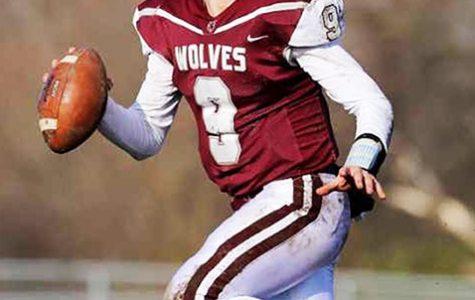 Connor Lydon, Prairie Ridge quarterback, leans back before a pass during the 2019 season.