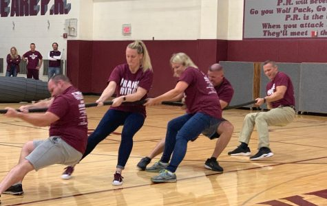 Losing tug of war at the Homecoming pep assembly was Alexis Kantner's most embarrassing moment. The winning faculty team included Mr. Peckhart, Mrs. Bluemlein, Mrs. Buck, Mr. Pecoraro, and Mr. Petersen.