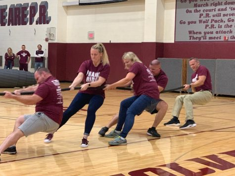 Losing tug of war at the Homecoming pep assembly was Alexis Kantner