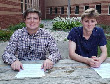 Seniors Grant Preves and Dimitri Vuyadinov smile for a picture after recording the first news team broadcast of the 2021-2022 school year.