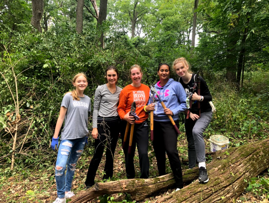 Members of the new Environmental Club pose for a picture during a Veteran Acres clean up day on September 4, 2021.