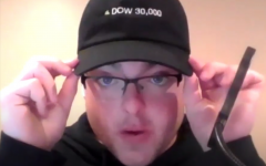 Senior news editor Grant Preves describes his hat that says DOW 30,000 during the September 26, 2021 recording of his Financial Festivities podcast.